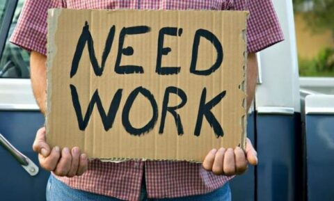 Man Holding Need Work Sign