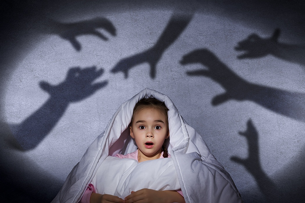 Scared Kid Surrounded By Shadow Hands