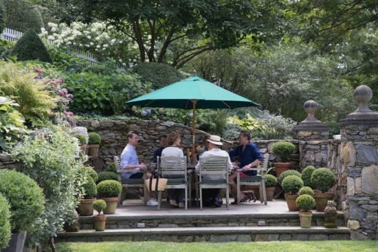 gathering on the patio surrounded by garden