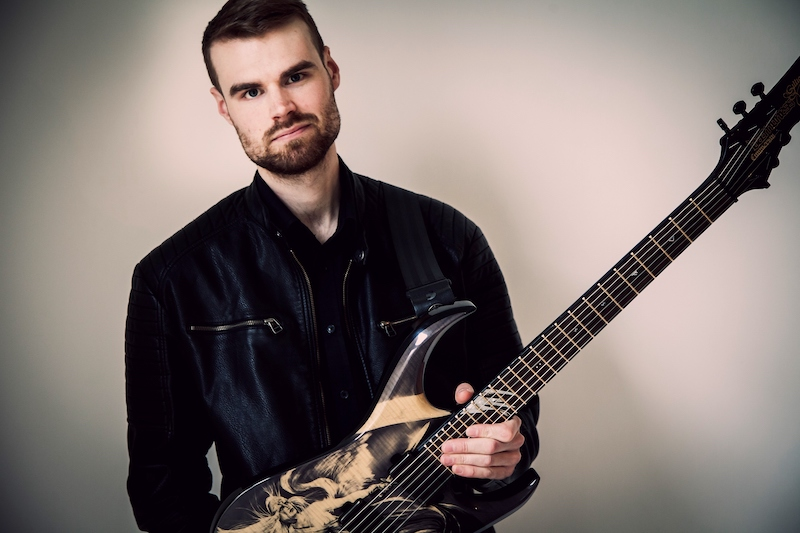 Andy with an awesome looking Daemoness guitar