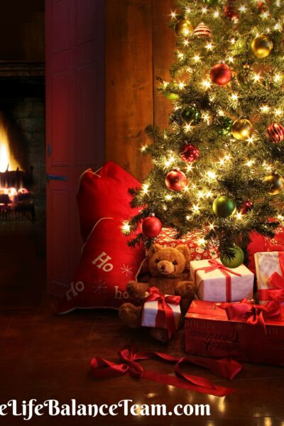 Christmas scene with tree gifts and fire in background-thelifebalanceteam.com