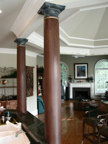 Faux wood columns with faux Marble Capitals