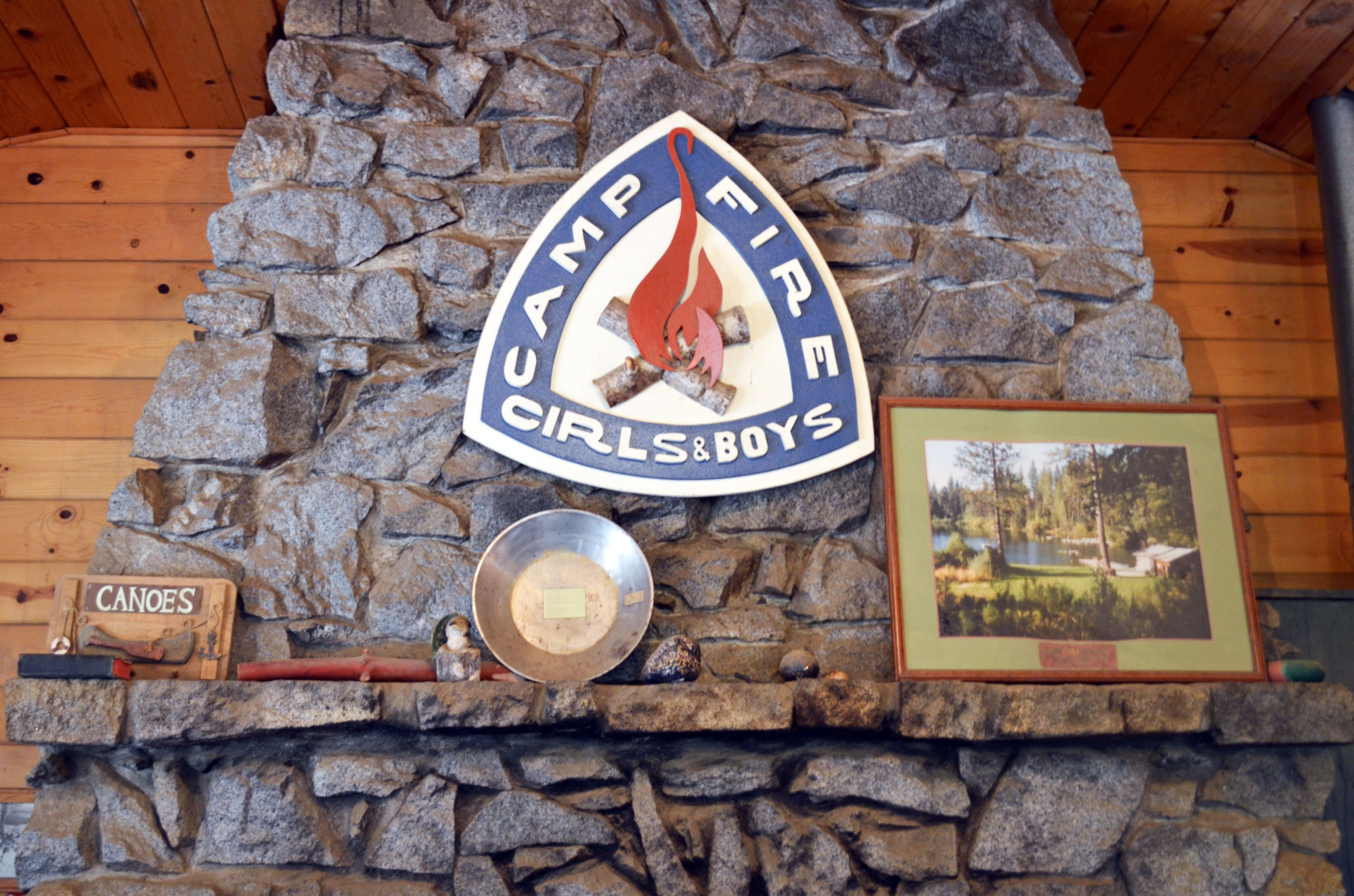 Camp Fire logo on fireplace hearth
