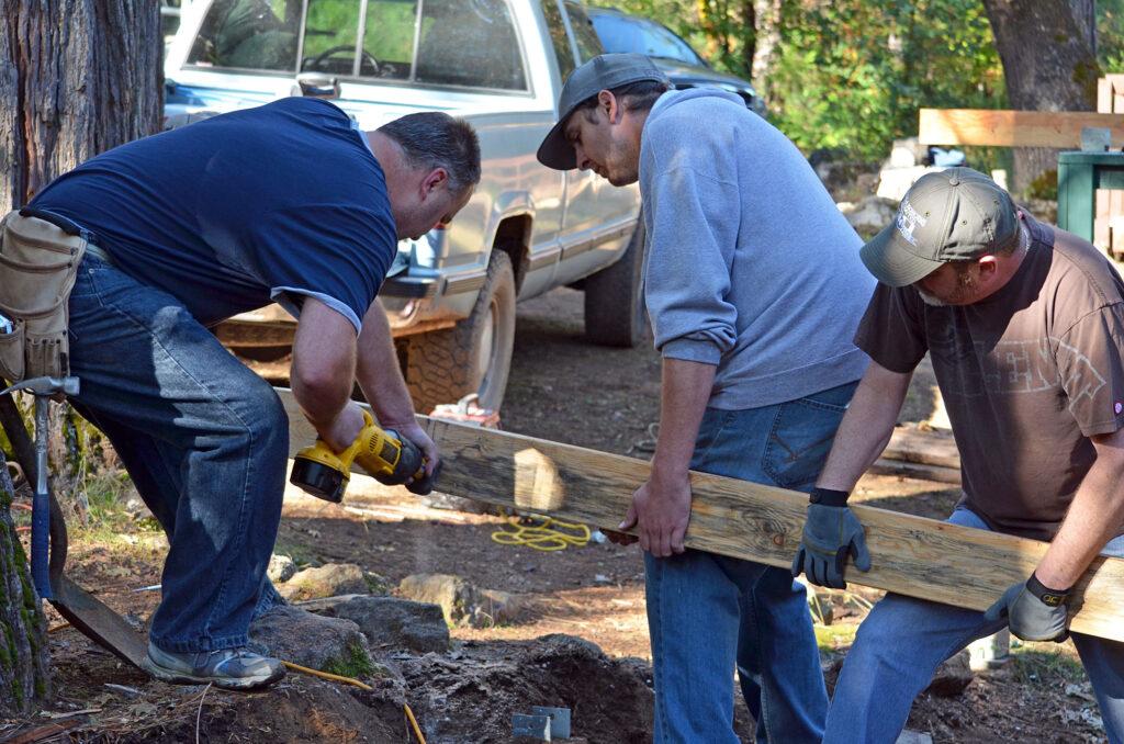 men working on large 2x4
