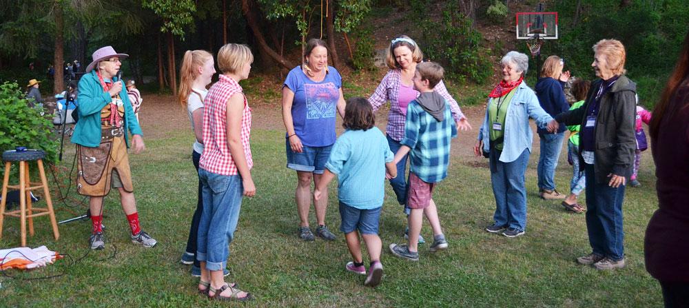 family dancing at camp