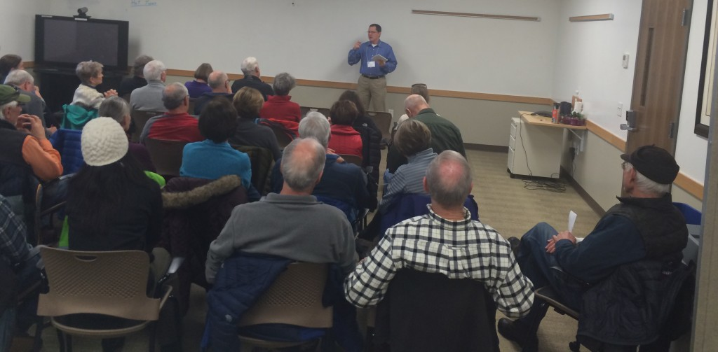Dan Slanina of Federal Highways in Seattle explains the Warren Wagon Road repaving project to a packed room at the Payette National Forest