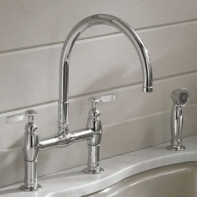 faucet mounted on counter top with sprayer