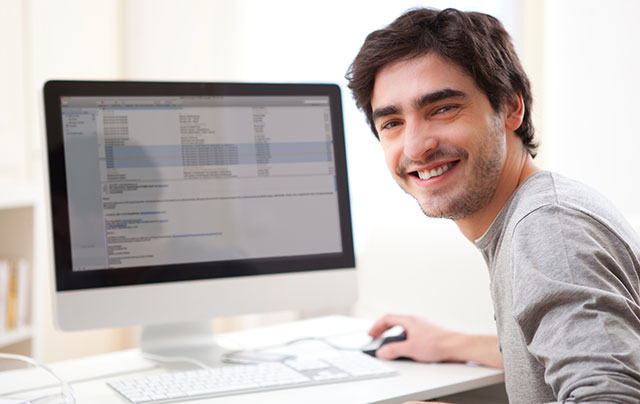 Man working on a computer from his home office