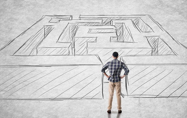 Man standing in front of a maze