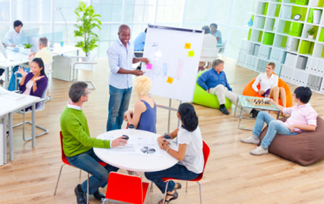people working together in an open office