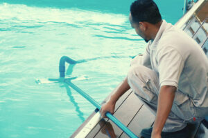 pool technician cleaning pool