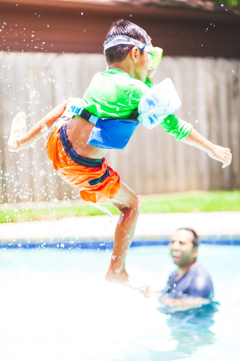 child jumping into the pool