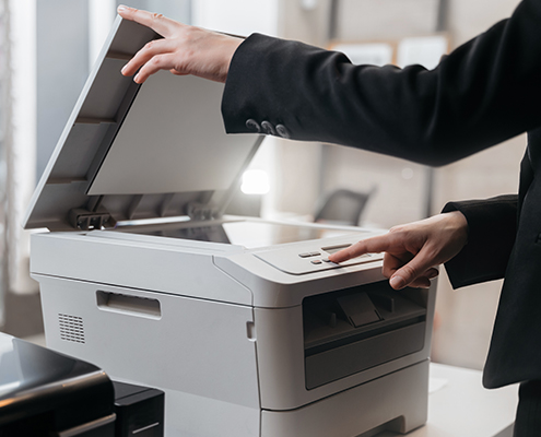 Office Copiers Printers Business woman is using the printer to scanning and printing document