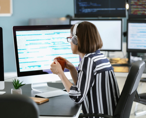 vCIO Female programmer working in office