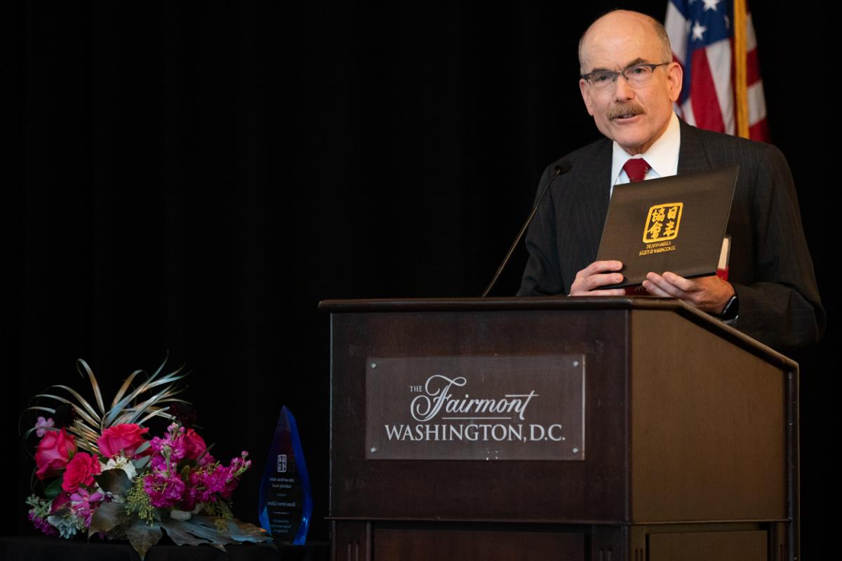 Ambassador James Zumwalt (JASWDC Chairman) presents the Marshall Green Award
