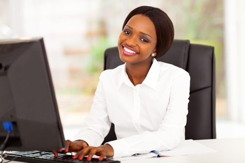 african businesswoman working on computer