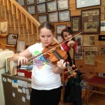Student Tori performs on one of the violins.