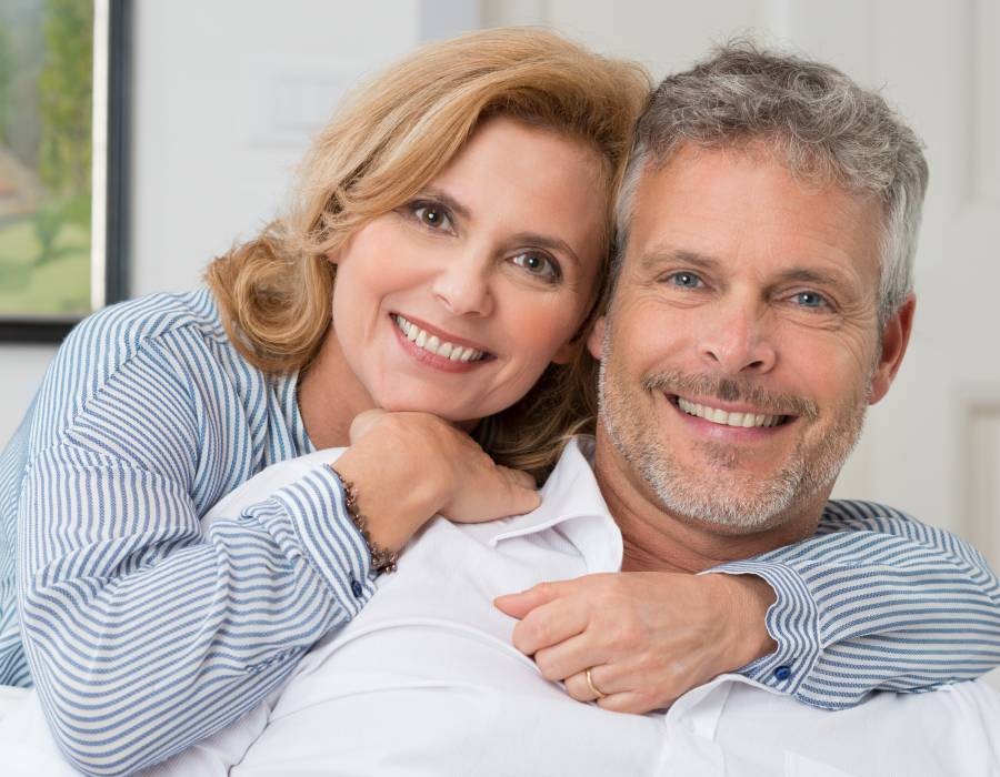 Portrait Of A Mature Couple Smiling And Embracing At Home