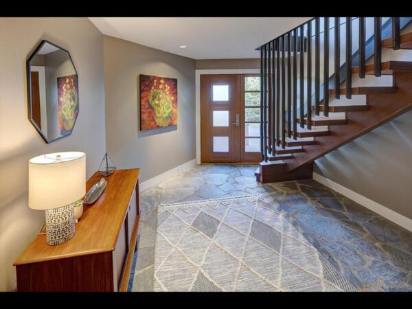 main entry with stone floors and custom door