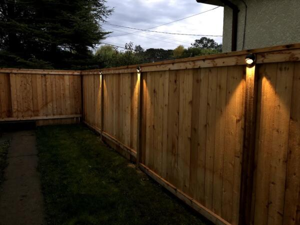accent lighting on fence
