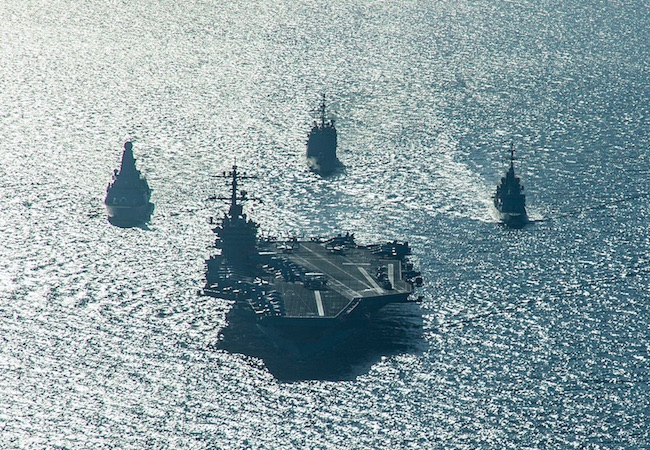 The USSCarl Vinson and support ships deployed for combat operations in Syria and Iraq. (Photo by US Navy: Courtesy of WikiCommons)