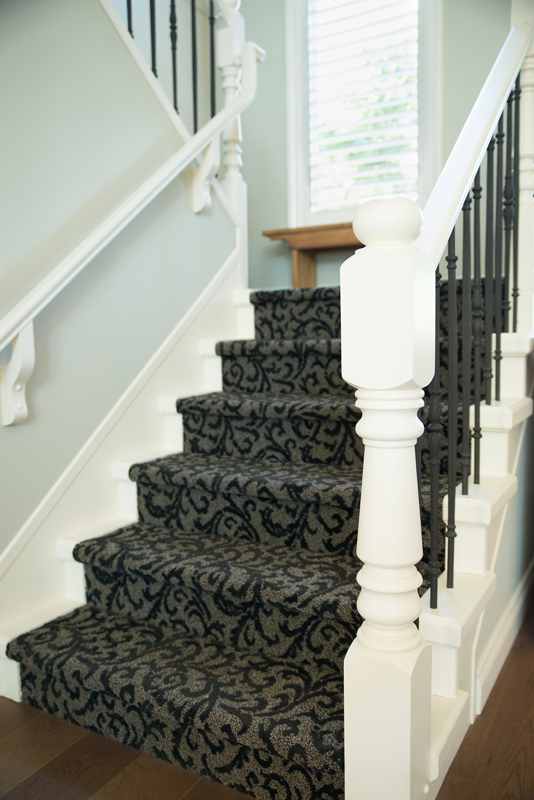 Carpeted stair and iron railings- we were bold with carpet.. the wood railings were replaced with iron to tie in the spiral staircase.