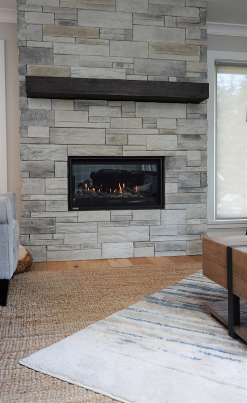 This stone fireplace makes for a cozy area to relax in the evenings.