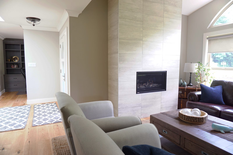 The front seating area combines a more modern marble fireplace, comfortable seating and lots of natural light.