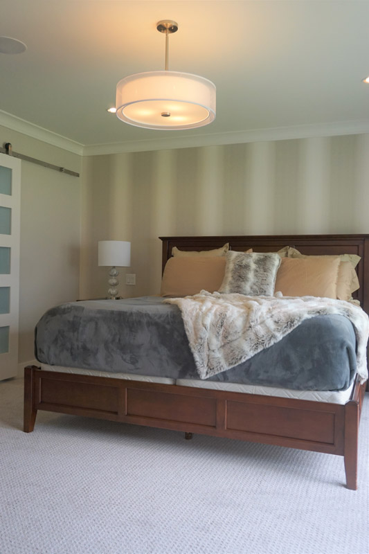 The bedroom features mixed patterns and materials that give layered depth.