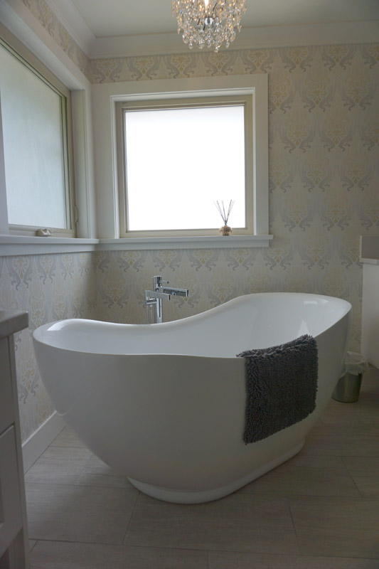 A distinct, tapered shape makes this freestanding tub a focal point in the master bath.