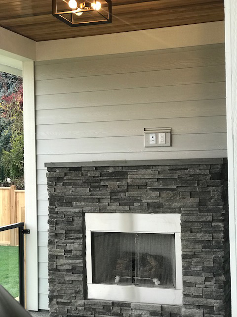 Covered outdoor entertaining area with gas fireplace
