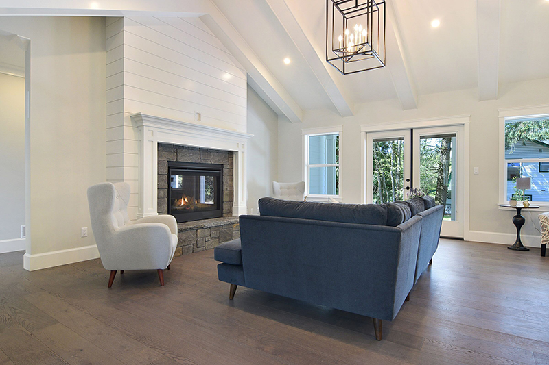 I like to use a lot of natural light which keeps this space bright and welcoming. The white buildout on this fireplace is tongue and groove which highlights the modern stone work on the firebox trim.