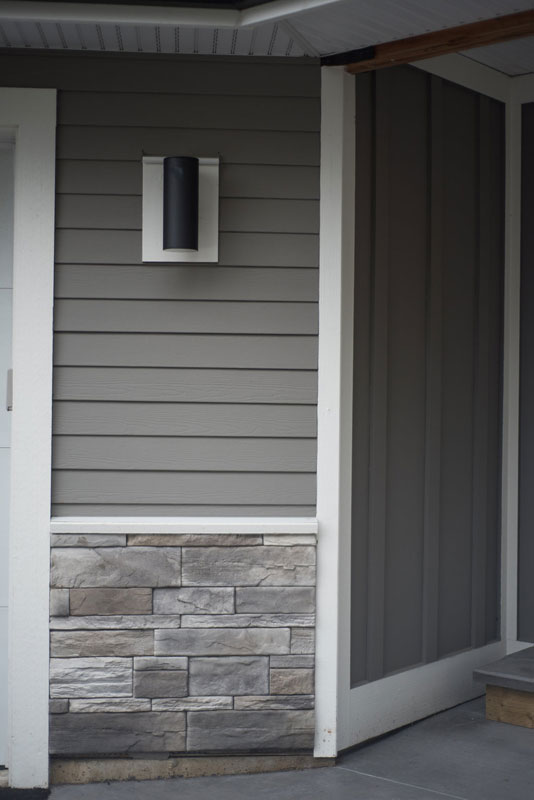 On the exterior and used a combination of horizontal and board and batton with some stone.