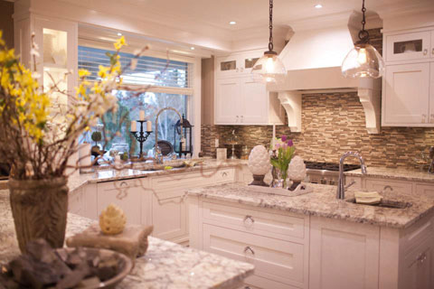 This large kitchen is inviting and makes a great space to cook and gather with friends.