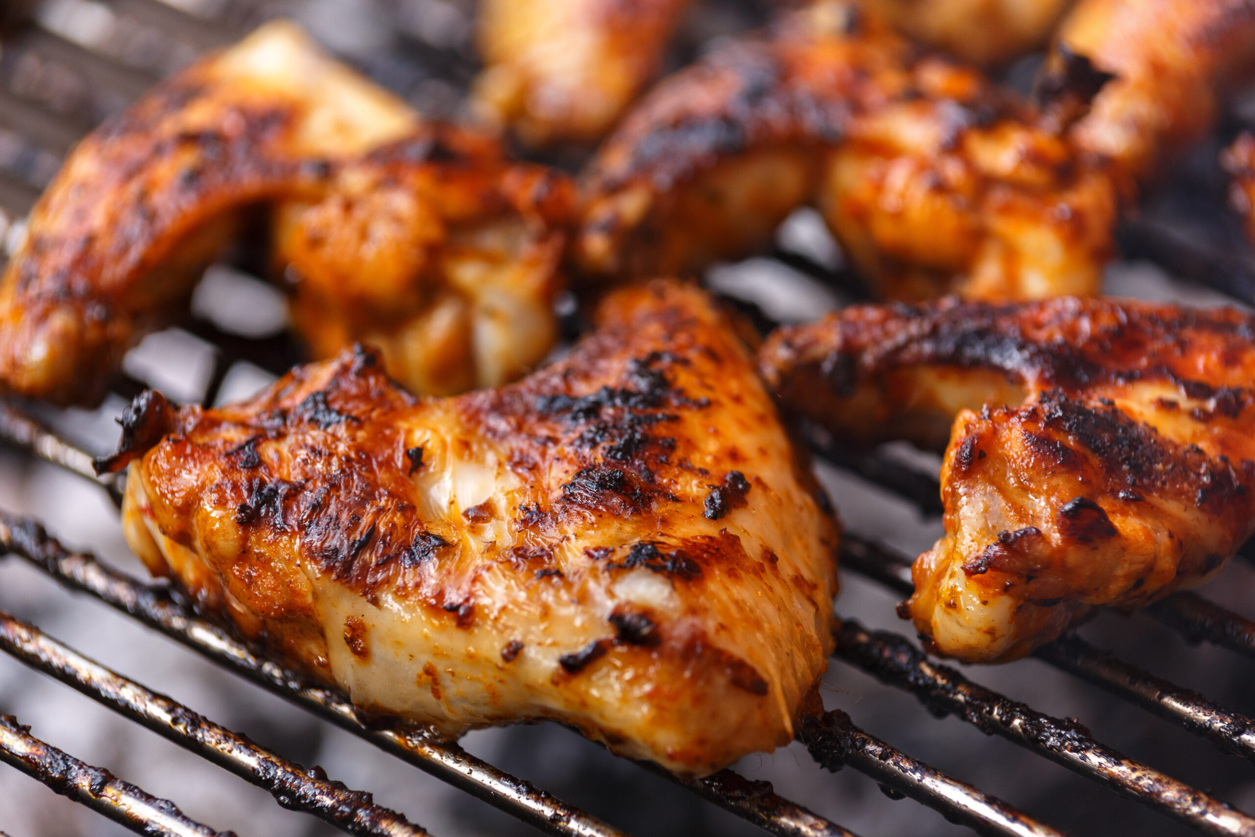 Chicken wings on barbecue, BBQ grill with fire