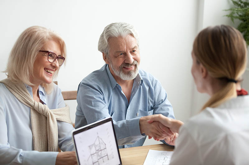 A couple in consultation with an agent