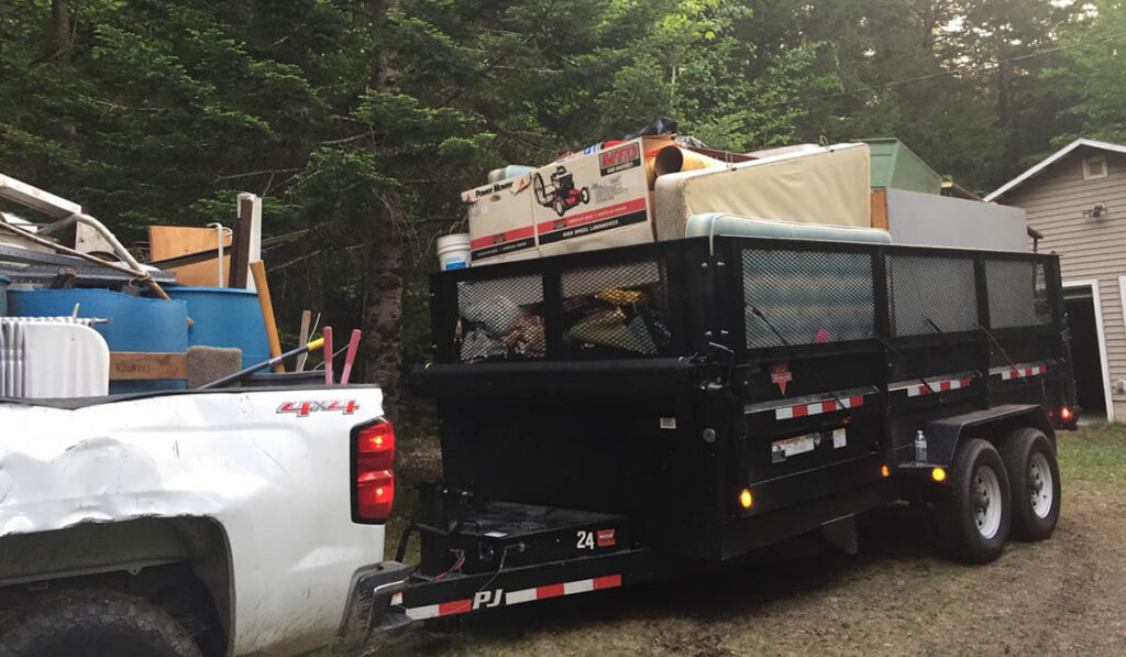 Hauling trash away from a home