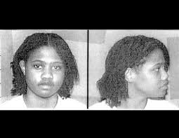 Two mug shots of a woman - one from the side, one from the front.
