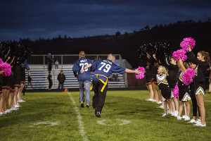Senior Trooper Scott Rector takes time to high five a young cheerleader as he is introduced to the crowd.
