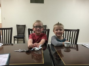 Chase Anderson and Josiah Marble made great friends. Here they are seen patiently waiting for their dinner to be served at Canton Wok, courtesy of the Pig Bowl Board, an annual tradition following the check presentation.