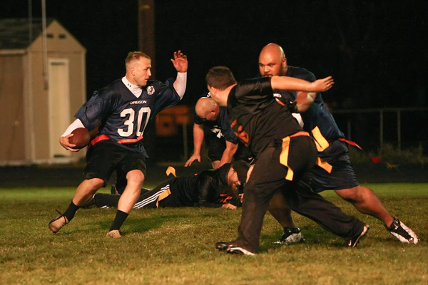 Corrections Deputy Ryan Atoe makes a great block as Dutton cuts up the field!