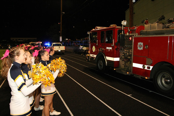 In this photo the Hood River Cheerleaders help welcome in the families riding in the procession