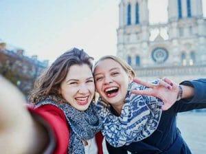 two woman taking selfie