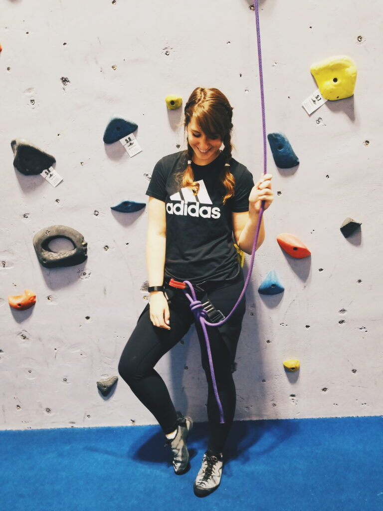 girl in front of rock climbing wall