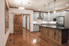 Modern Kitchen Design  Barn Door Accent Touch Weaverville