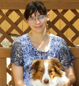 Miss Abby Cadenhead poses with dog