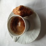 Cappuccino with a small croissant
