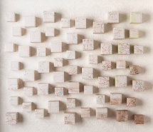 The Stretching Plains (pink), 2009, hand cut paper cubes & wallpaper, 70 x 81 x 10 cm