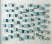 The Widening Sea (blue), 2009, hand cut paper cubes & wallpaper, 70 x 81 x 10 cm