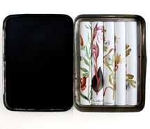 Collect, 2008, rolled paper & tobacco tin, 10 x 8 x 1.8 cm